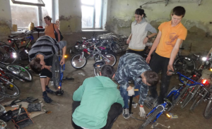 Volunteers put pedals back onto the bikes in Moldova.