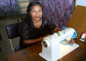 An eager sewing student in the FIDESMA sewing classroom.