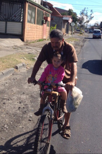 Javier and daughter on their daily ride