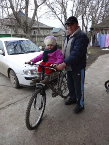 Taking his granddaughter to kindergarten