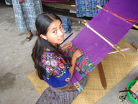 Maria using the hand loom